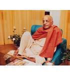 Srila Prabhupada Sitting Relaxed on Blue Seat